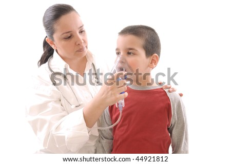 Medical doctor using oxygen mask on her child patient. White background studio picture.