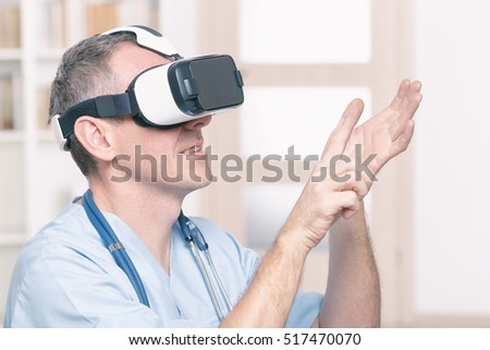 Medical doctor using virtual reality headset at his work