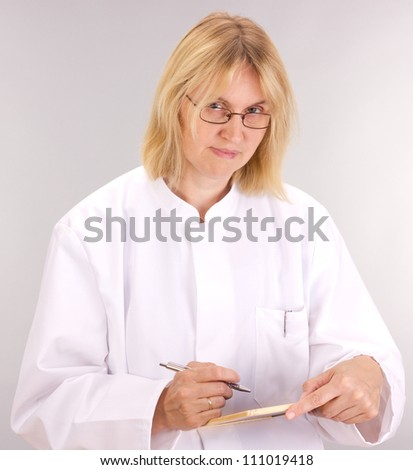 Medical doctor with blackboard - stock photo