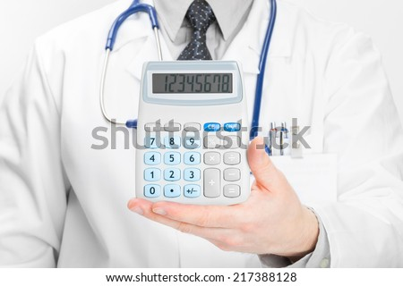 Medical doctor with calculator in his hand - health care concept - stock photo