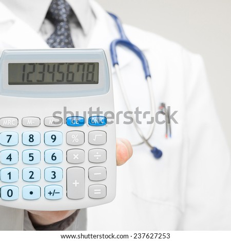 Medical doctor with calculator in his hand - health care concept
