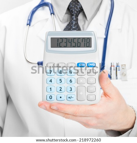 Medical doctor with calculator in his left hand - 1 to 1 ratio - stock photo