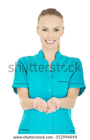 Medical doctor woman showing something on open palms.