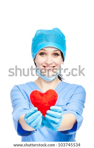 medical doctor woman smile hold red heart. nurse wear blue surgery suit gloves mask cap, Isolated over white background - stock photo