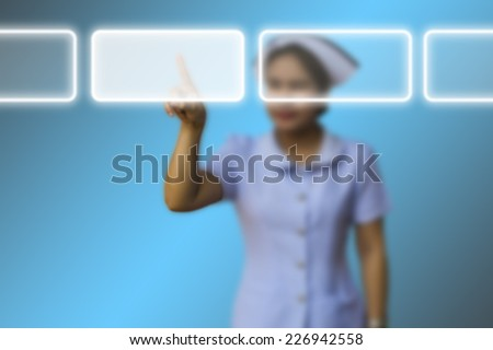 Medical doctor woman use innovative technologies and touch empty touchscreen with empty icon copy space in the air  - stock photo