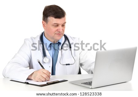Medical doctor working at desk isolated on white - stock photo