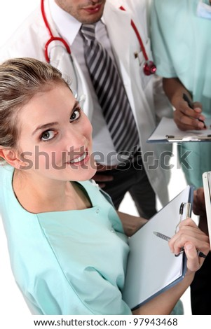 Medical doctors exchanging opinions - stock photo