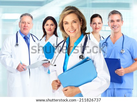 Medical doctors team over blue hospital background
