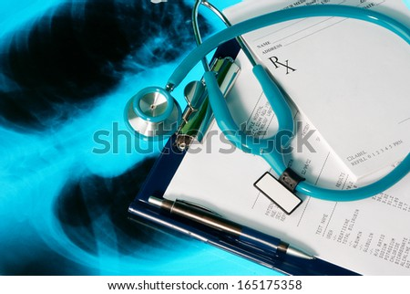 Medical documents (blood test and prescription) with a stethoscope on Xray photo of lungs - stock photo