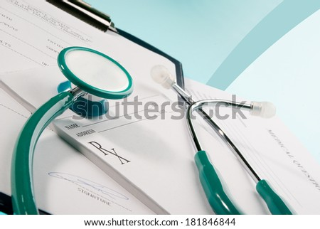 Medical documents (medical questionnaire, prescription and blood test) with a stethoscope on blue background - stock photo