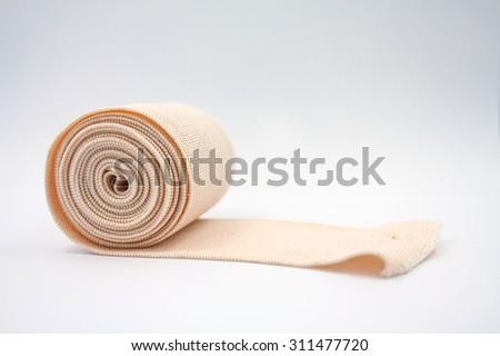 medical elastic bandage on white background - stock photo