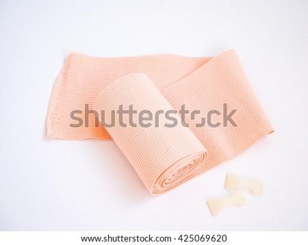Medical elastic cotton bandage - stock photo