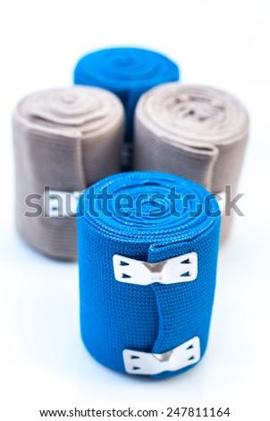 medical elastic tensor bandage with reflection on white background - stock photo
