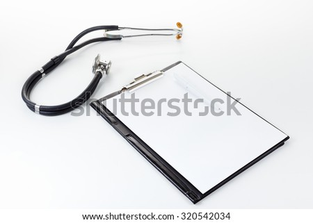 Medical elements - stetoscope. On the light surface - stock photo