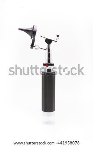 Medical equipment diagnostic ear exam.Otoscope on white background with clipping path - stock photo