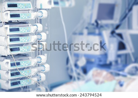 Medical equipment for intravenous infusion close to the patient - stock photo