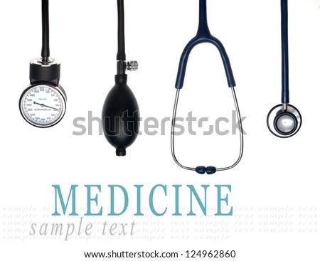Medical equipment isolated on white (stethoscope and sphygmomanometer) - stock photo