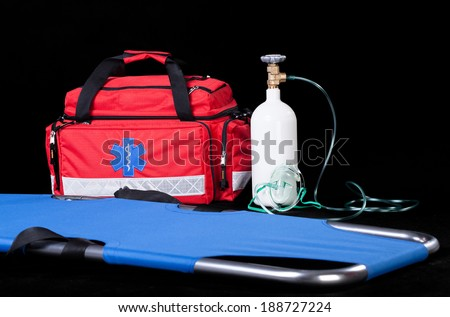 Medical equipment on isolated black background, horizontal - stock photo