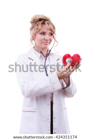 Medical examination of cardiology. Middle aged cardiologist with heart and stethoscope. Female doctor in white uniform makes measurement heartbeat. Isolated on white. - stock photo