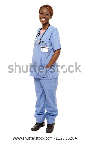 Medical expert posing with hands in her uniform isolated over white background - stock photo