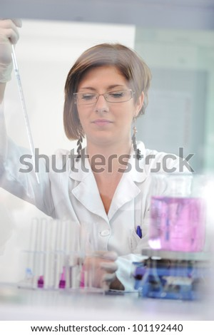 Medical female scientist working in laboratory - stock photo