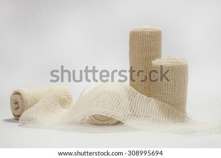 Medical flexible bandage on the white background. - stock photo