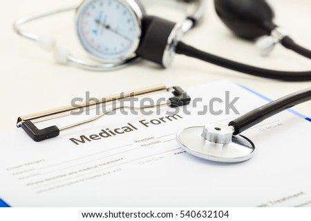 Medical form and a stethoscope on white background