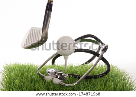 Medical golf scene on a tee in the photo studio  - stock photo