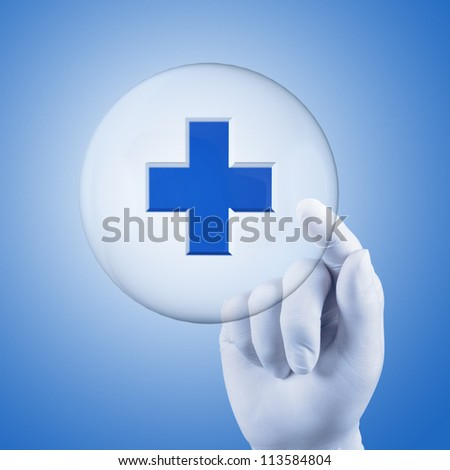 medical hand with glove select on first aid sign - stock photo