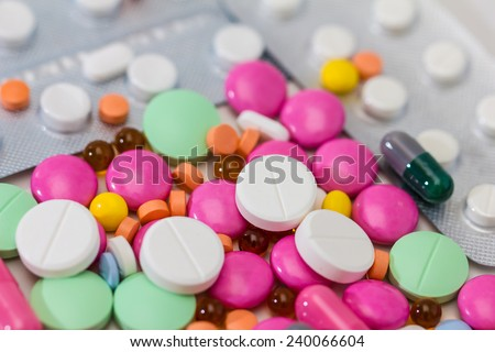 Medical / health-care concept: some medical colorful pills - stock photo