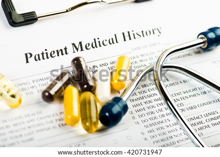 Medical history document with medicine and stethoscope