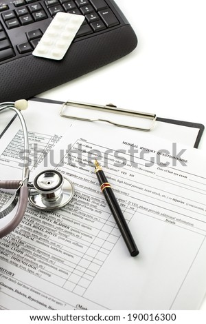 Medical history with stethoscope Keyboard and pen - stock photo