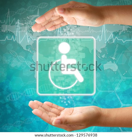 Medical icon Disabled in hand - stock photo