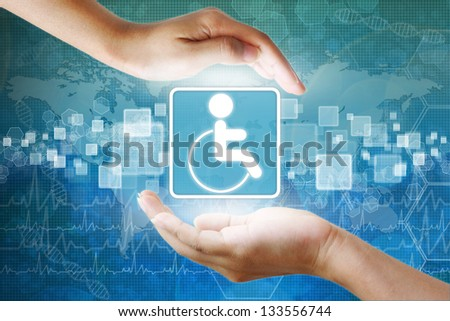 medical icon, Disabled symbol in hand - stock photo
