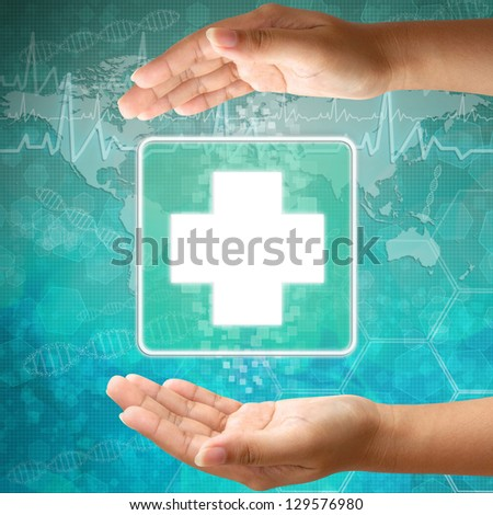 Medical icon First Aid  in hand - stock photo