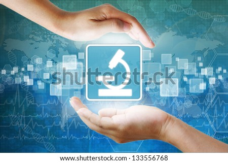 medical icon, Microscope symbol in hand - stock photo