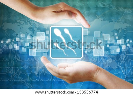 medical icon, Spermatozoon symbol in hand - stock photo