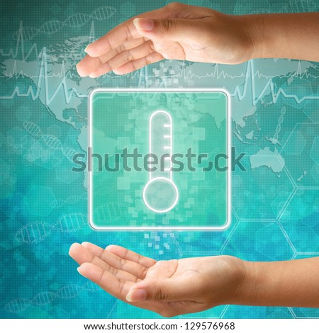 Medical icon Thermometer in hand - stock photo