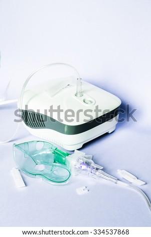 Medical inhaler, nebulizer, nebular. Respiratory medicine. Asthma breathing treatment. Bronchitis, asthmatic health equipment. Illness care - stock photo