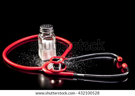 Medical instrument and salt isolated on black background with reflection - stock photo