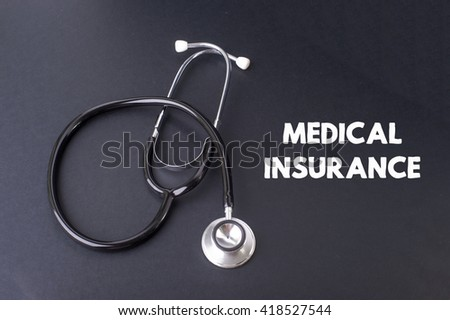 Medical Insurance word with stethoscope - health concept. Medical conceptual.