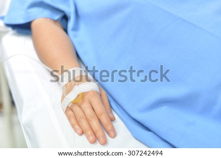 Medical intravenous fluid cannula on right hand