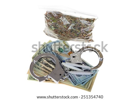 medical marijuana, money, and Hand Cuffs isolated on white. Representing the confusion of Legal Medical Marijuana and the laws between States and the US Government. Medical Marijuana is a legal drug - stock photo