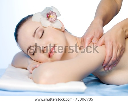 Medical massage of shoulder of young beautiful woman - horizontal