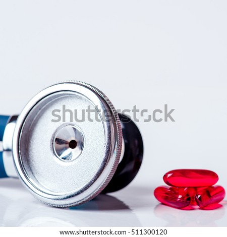 Medical, medicine stethoscope and pills on blue background. Health care or illness. Tablet or drug in hospital or pharmacy. Cardiology heart treatment. Medication prescription