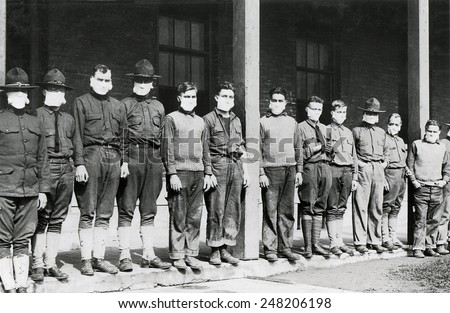 Medical men wore masks to avoid the flu at U.S. Army hospital. Nov. 19, 1918. Army Hospital No. 4. Fort Porter, N.Y. during the 1918-19 'Spanish' Influenza pandemic. - stock photo