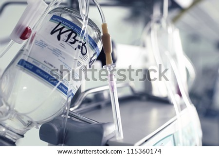 medical needle for intravenous infusion against medical devices and equipment - stock photo