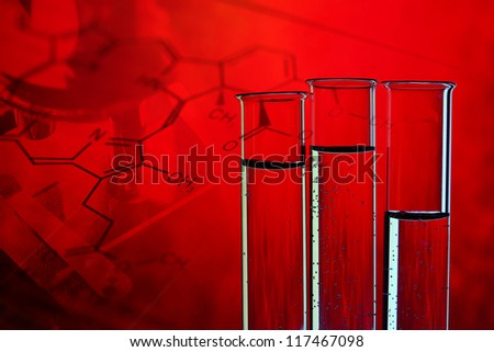 Medical or chemistry science background with microscope and test tubes - stock photo