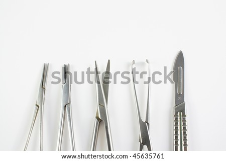 Medical or surgical instruments used in surgery over white background
