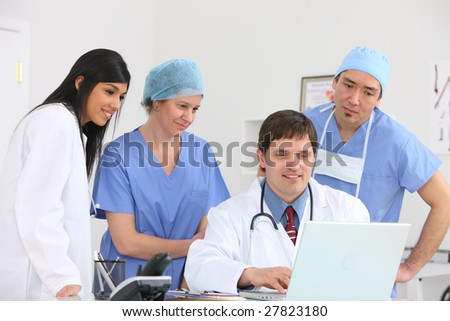 Medical personnel looking at laptop computer